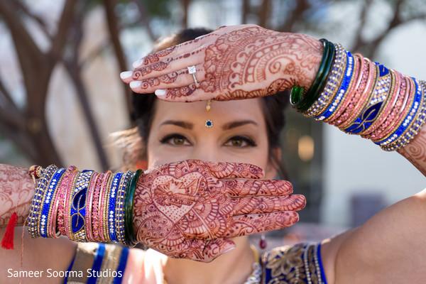 indian bride makeup,indian bride getting ready,indian wedding design