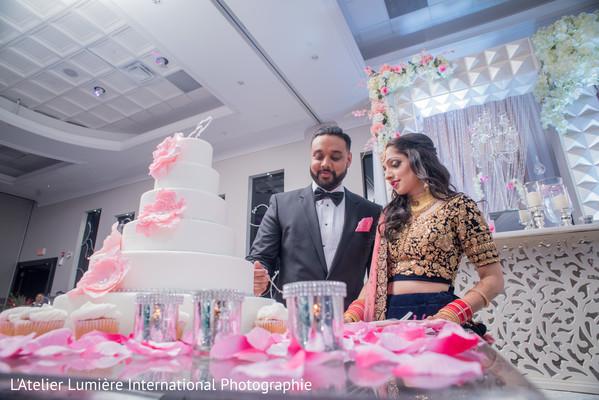 Lovebirds cut their wedding cake.