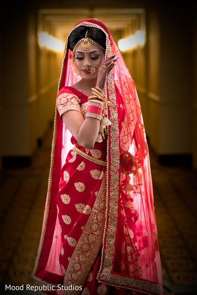 Indian bride red traditional wedding look.