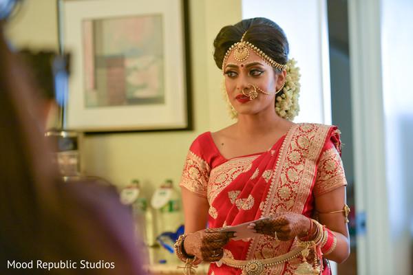 Bengali bride touching moment.