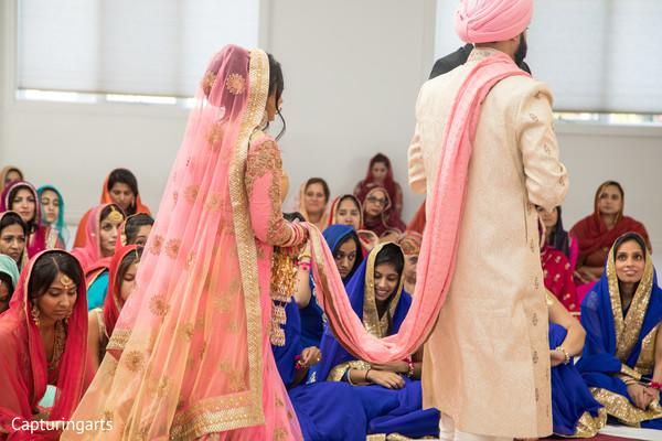 pink dupatta,beige sherwani