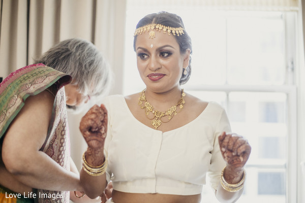 indian bride getting ready,indian wedding henna,indian bride hair and makeup
