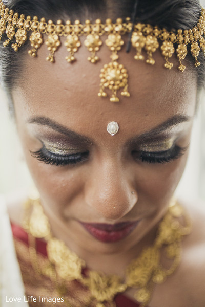 indian bride makeup,bridal tikka,indian bride
