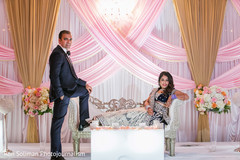 indian bride,indian groom,indian fusion wedding reception,reception stage.