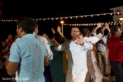 Indian wedding guests dancing at sangeet ceremony