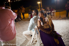 Indian couple having a great time at sangeet ceremony