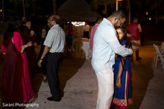 Indian groom and his daughter dancing at sangeet ceremony