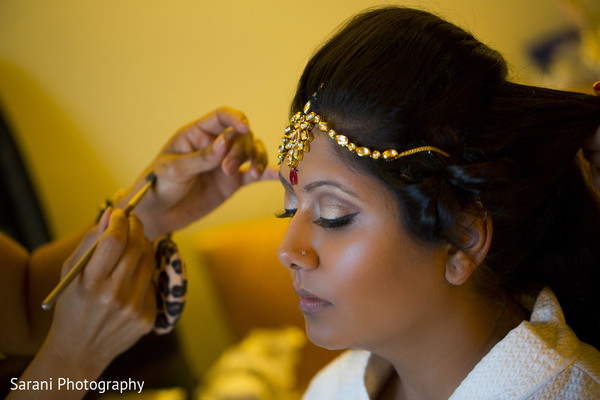 indian bride hair and makeup,bridal tikka,indian bride