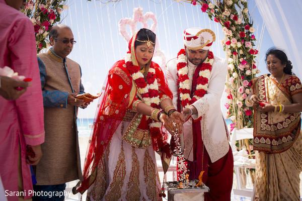 indian groom sherwani,indian bride and groom,outdoor indian wedding decor