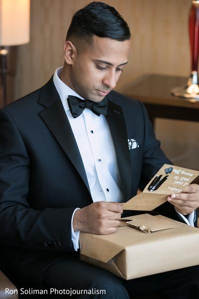 Groom reading love note