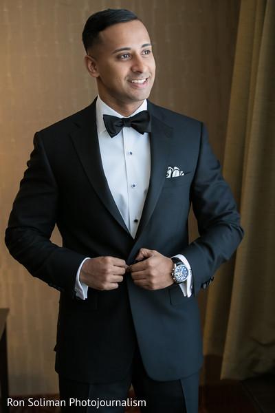 Handsome groom in black suit