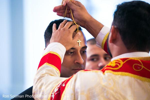 Groom receiving blessing