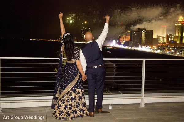 indian fusion wedding reception,fireworks,indian groom fashion
