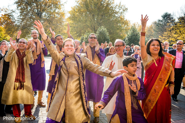 Colorful baraat procession. in Virginia Fusion Wedding by Photographick Studios