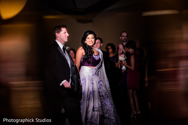 Indian couple making their great entrance. in Virginia Fusion Wedding by Photographick Studios