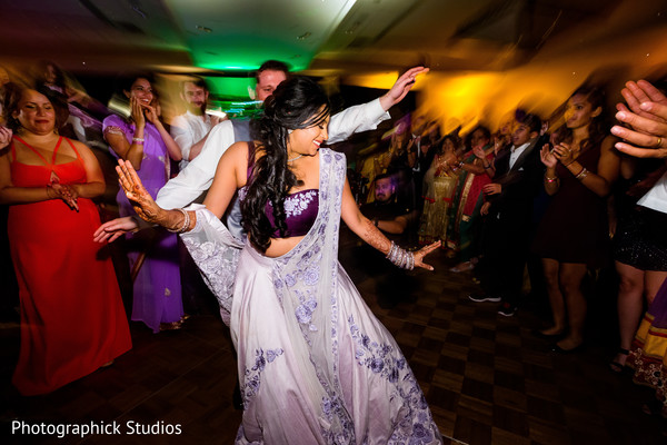 Over the top indian wedding reception. in Virginia Fusion Wedding by Photographick Studios