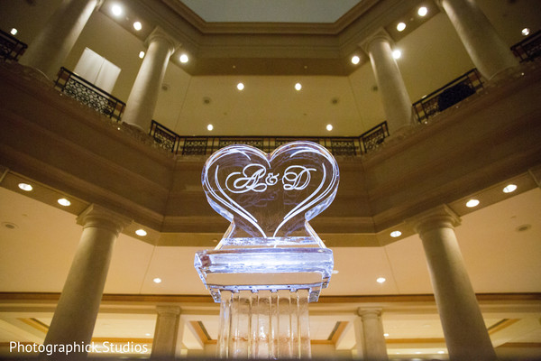 Impressive ice sculpture. in Virginia Fusion Wedding by Photographick Studios