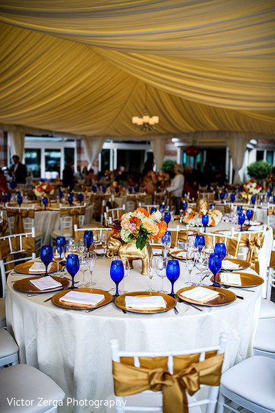 Gold and white themed wedding reception. in Kirkland, WA Indian Wedding by Victor Zerga Photography