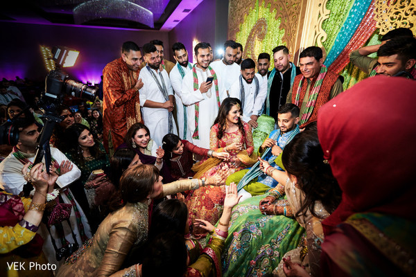 Indian couple, groomsmen and bridesmaids having a good time at mehndi party