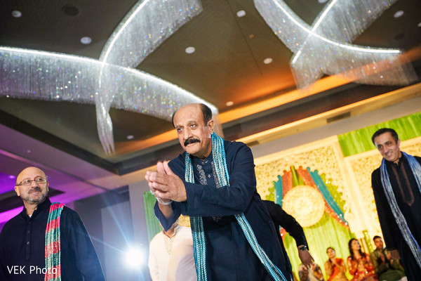 Indian wedding guests dancing at mehndi party