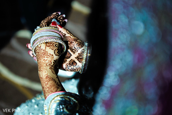 Indian bride trying her bangles before wedding reception in Dallas, TX Pakistani Wedding by VEK Photography