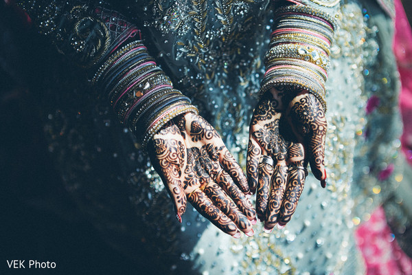 Indian bride showing her mehndi art photography in Dallas, TX Pakistani Wedding by VEK Photography
