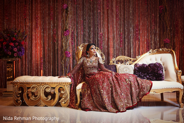 Pakistani bride posing at the wedding stage. in Dallas, TX Pakistani Wedding by Nida Rehman Photography