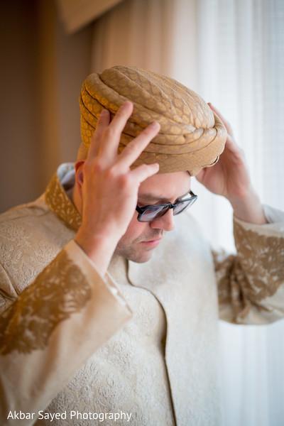 Groom putting on his turban