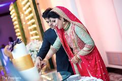 cutting the cake,indian wedding cakes