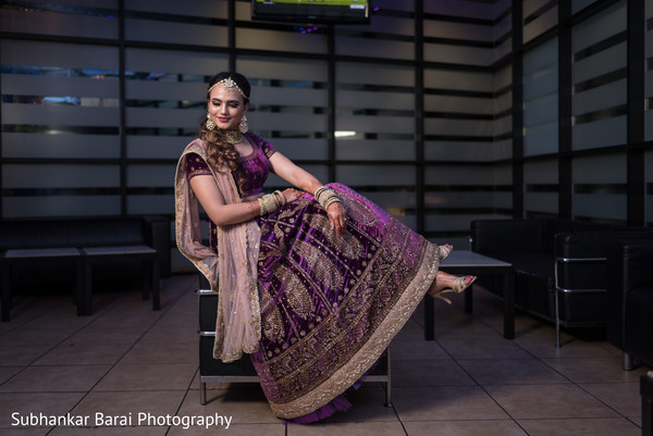 Beautiful maharani in a deep purple lengha.