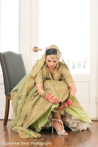 Gorgeous indian bride in light green lengha.