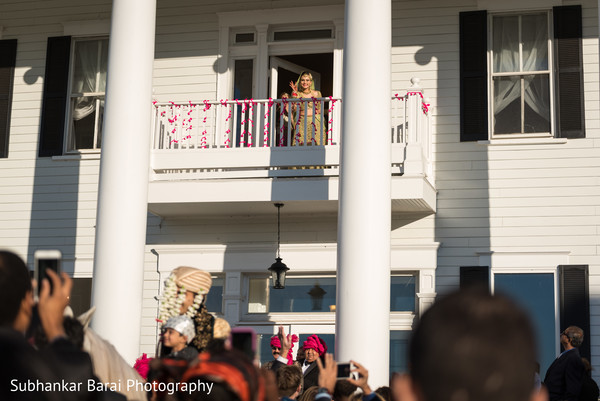 Bride taking a look from her balcony.
