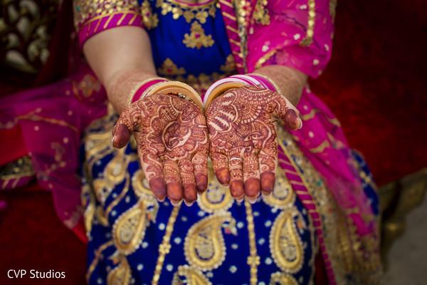 Lovely reddish bridal design.