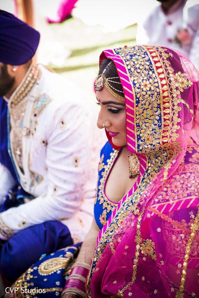 Sikh bride glowing in her wedding ceremony.