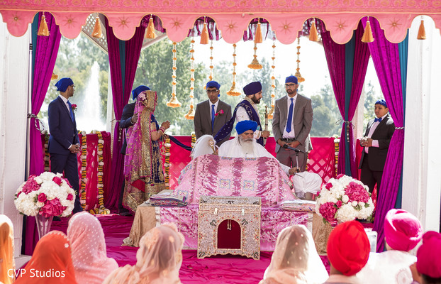 Sikh couple exchanging vows.
