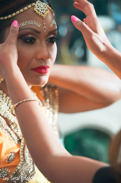 Gorgeous bride's final touch ups. in Westchester, New York Fusion Indian Wedding by Jay Seth Photography