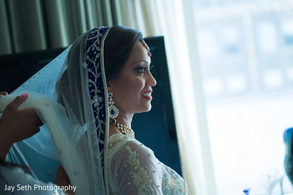 indian bride makeup,indian bride getting ready,indian bride,indian fusion wedding reception