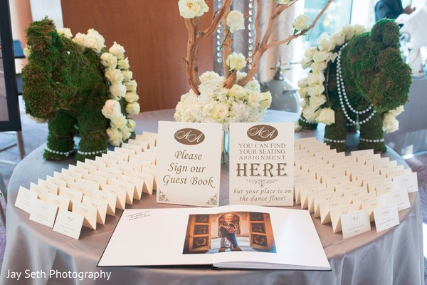 Guest book and seating cards table. in Westchester, New York Fusion Indian Wedding by Jay Seth Photography
