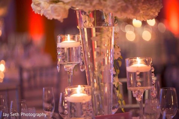Floating candles as table centerpieces. in Westchester, New York Fusion Indian Wedding by Jay Seth Photography