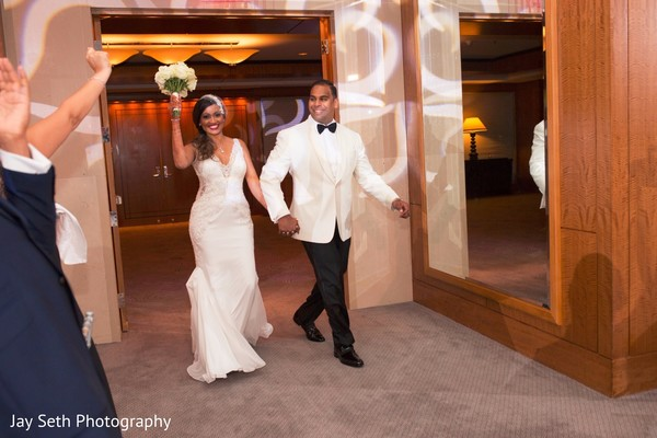 Bride and groom in white . in Westchester, New York Fusion Indian Wedding by Jay Seth Photography