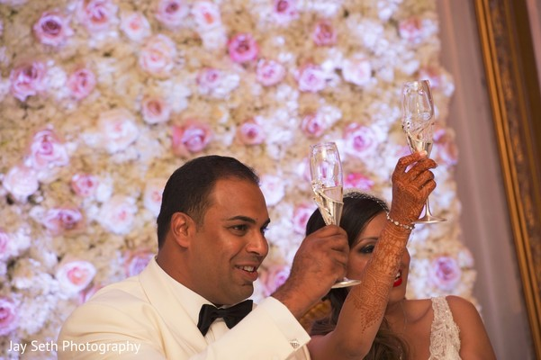 Wedding toast. in Westchester, New York Fusion Indian Wedding by Jay Seth Photography
