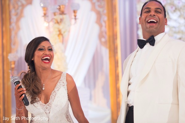 Wedding reception candid moment. in Westchester, New York Fusion Indian Wedding by Jay Seth Photography