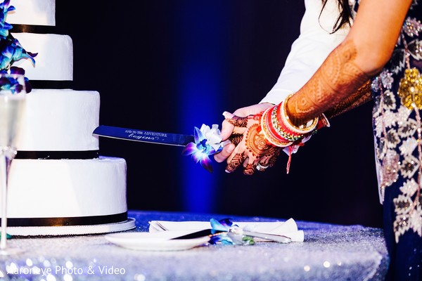 Indian couple about to cut the cake at wedding reception in San Diego, CA Indian Wedding by Aaroneye Photography
