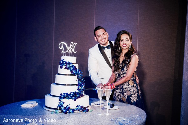 Indian couple cutting the cake at wedding reception in San Diego, CA Indian Wedding by Aaroneye Photography