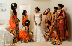 Bridesmaids helping the bride to get ready.