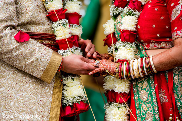 Adorable indian couple exchanging rings.