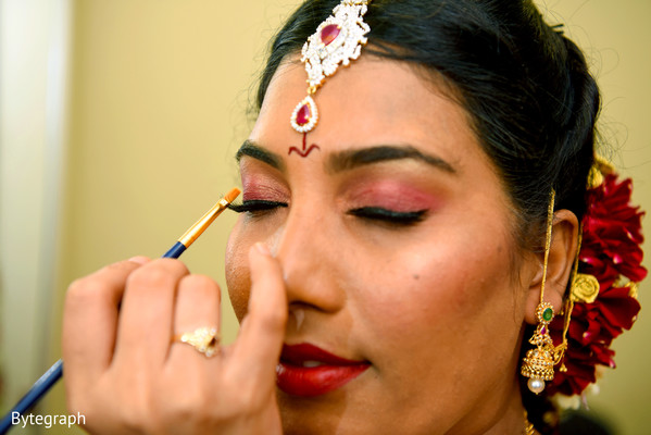 indian bride makeup,indian bride getting ready,indian bride