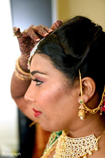 bridal tikka,mehndi art,indian bride makeup,indian bride getting ready