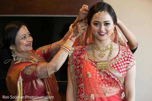 indian bridal hair and makeup,indian bride getting ready,bridal ceremony fashion
