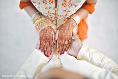Indian groom holding bride's hands photography